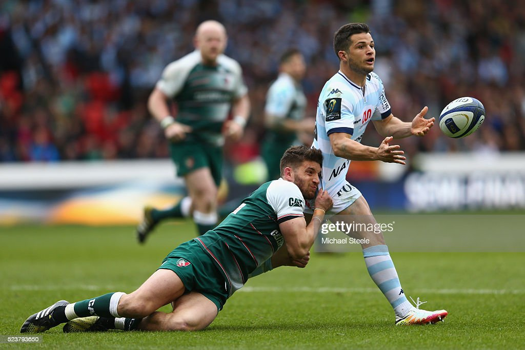 Brice Dulin of Racing 92 offloads the ball as Owen Williams of Leicester tackles during the European Rugby Champions Cup Semi-Final match between Leicester Tigers and Racing 92 at the City Ground on April 24, 2016 in Nottingham, England.