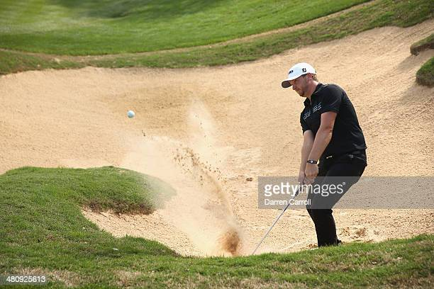 Brice Garnett takes his third shot form the bunker on the 18th during Round One of the Valero Texas Open at the ATT Oaks Course on March 27 2014 in...