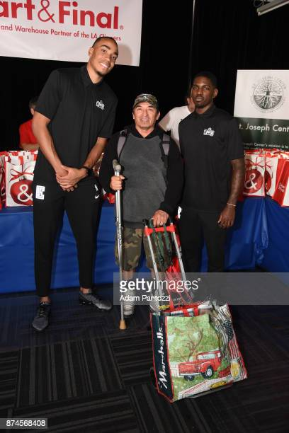 Brice Johnson and Jawun Evans of the LA Clippers help host their 29th Annual Teamwork at the Table Thanksgiving event at St Joseph Center on November...