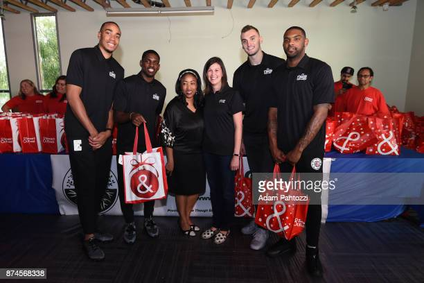 Brice Johnson Jawun Evans Sam Dekker and Sindarius Thornwell of the LA Clippers help host their 29th Annual Teamwork at the Table Thanksgiving event...