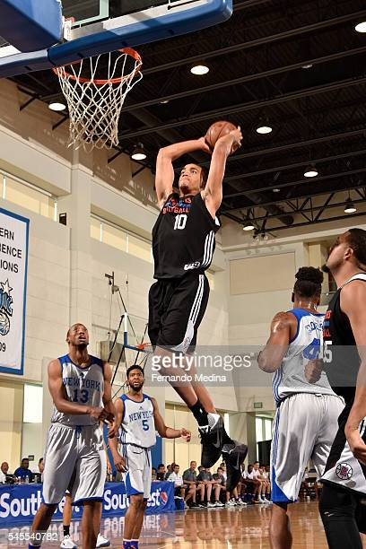 Brice Johnson of Los Angeles Clippers dunks against the New York Knicks during 2016 Summer League on July 8 2016 at the Amway Center in Orlando...