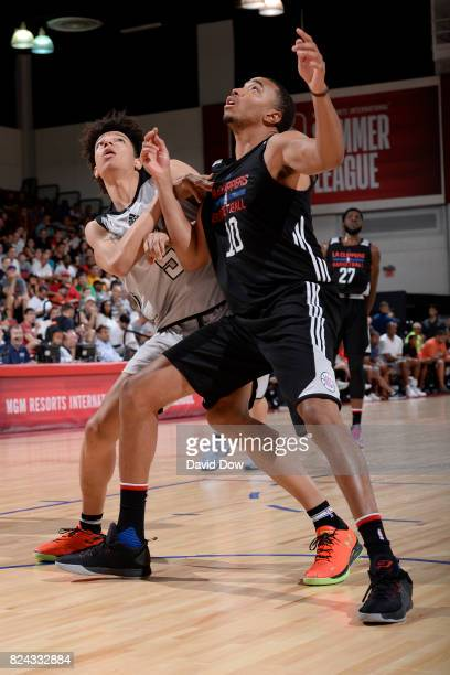 Brice Johnson of the Los Angeles Clippers fights for the position against DJ Wilson of the Milwaukee Bucks during the 2017 Las Vegas Summer League on...