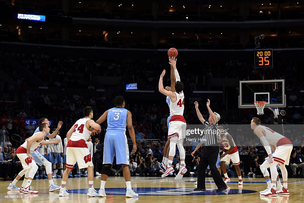Brice Johnson of the North Carolina Tar Heels and Frank Kaminsky of the Wisconsin Badgers go after the opening jump ball during the West Regional...