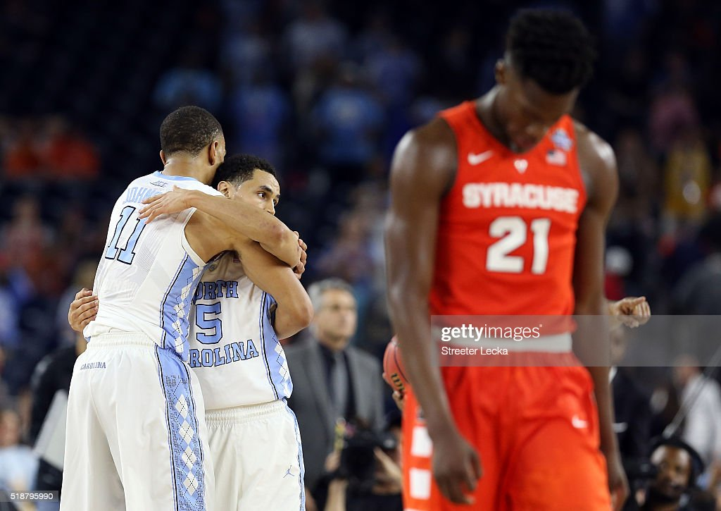 Brice Johnson of the North Carolina Tar Heels and Marcus Paige celebrate defeating the Syracuse Orange 8366 as Tyler Roberson of the Syracuse Orange...