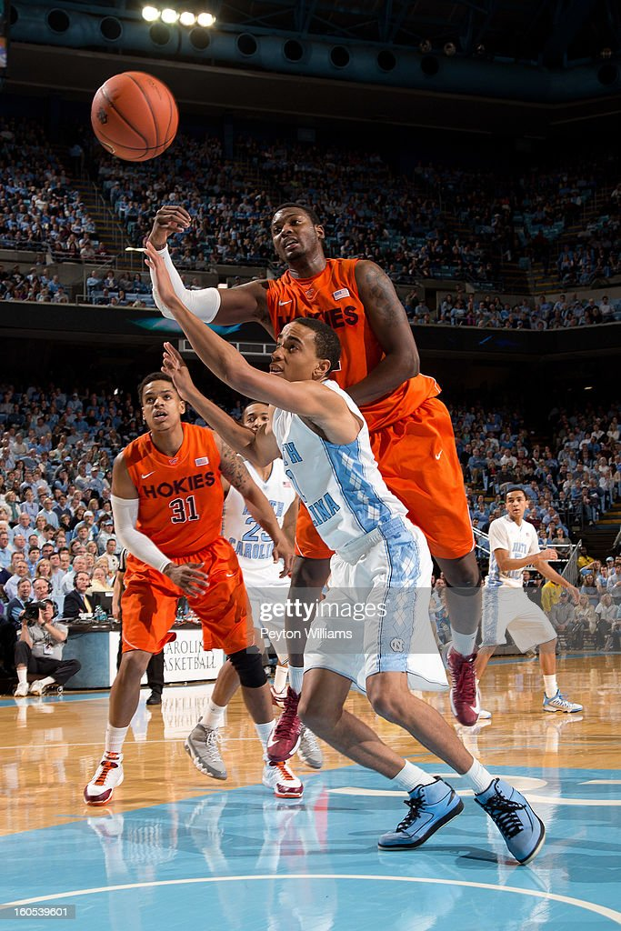 Brice Johnson #11 of the North Carolina Tar Heels battles forward Cadarian Raines #4 of the Virginia Tech Hokies for possession during the first half on February 02, 2013 at the Dean E. Smith Center in Chapel Hill, North Carolina.