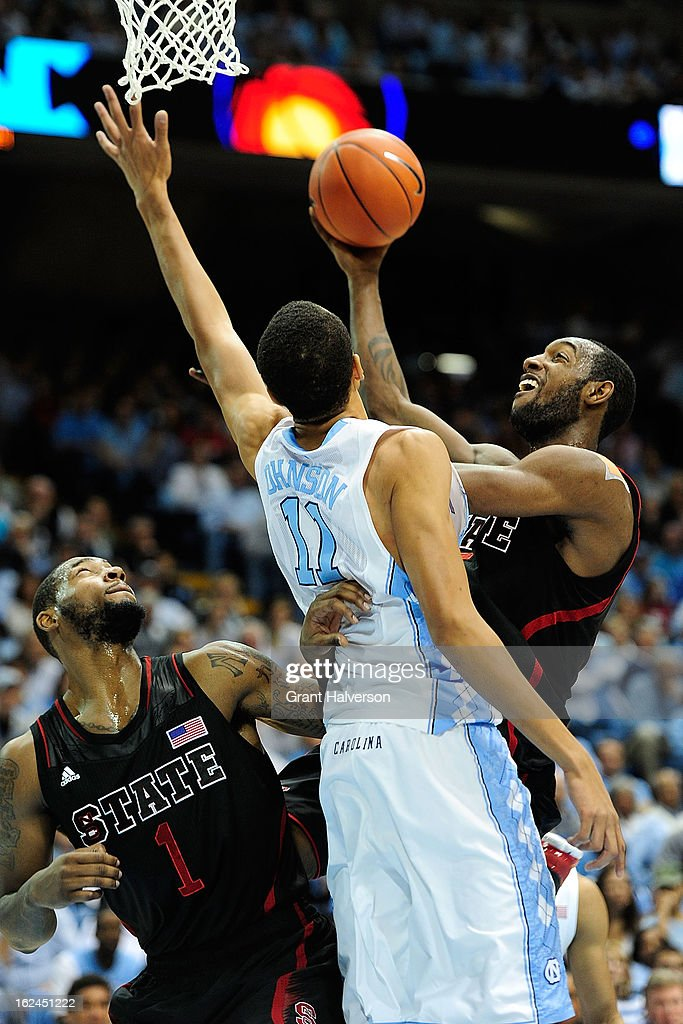 Brice Johnson #11 of the North Carolina Tar Heels defends a shot by <a gi-track='captionPersonalityLinkClicked' href=/galleries/search?phrase=C.J.+Leslie&family=editorial&specificpeople=6902920 ng-click='$event.stopPropagation()'>C.J. Leslie</a> #5 of the North Carolina State Wolfpack during play at the Dean Smith Center on February 23, 2013 in Chapel Hill, North Carolina.