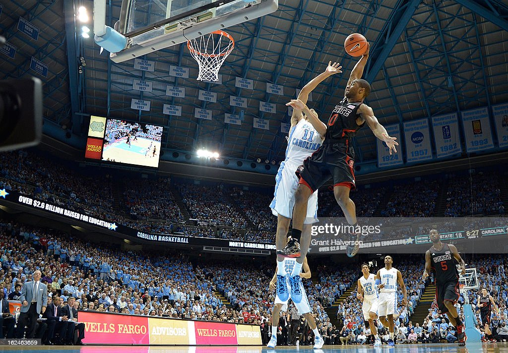 Brice Johnson #11 of the North Carolina Tar Heels defends a shot by Rodney Purvis #0 of the North Carolina State Wolfpack during play at the Dean Smith Center on February 23, 2013 in Chapel Hill, North Carolina. North Carolina won 76-65.