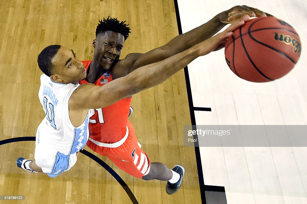 Brice Johnson of the North Carolina Tar Heels defends a shot by Tyler Roberson of the Syracuse Orange in the first half during the NCAA Men's Final...