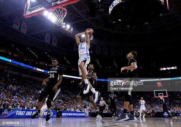 Brice Johnson of the North Carolina Tar Heels drives for a dunk against the Providence Friars during the second round of the NCAA Men's Basketball...