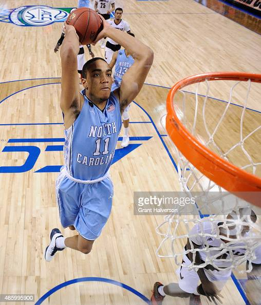 Brice Johnson of the North Carolina Tar Heels dunks against the Louisville Cardinals during the quarterfinals of the ACC Basketball Tournament at...