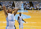 Brice Johnson of the North Carolina Tar Heels dunks against the Wake Forest Demon Deacons during their game at the Dean Smith Center on January 20...