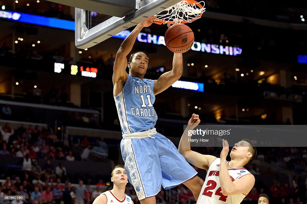 <a gi-track='captionPersonalityLinkClicked' href=/galleries/search?phrase=Brice+Johnson+-+Basketball+Player&family=editorial&specificpeople=13908967 ng-click='$event.stopPropagation()'>Brice Johnson</a> #11 of the North Carolina Tar Heels dunks the ball against <a gi-track='captionPersonalityLinkClicked' href=/galleries/search?phrase=Bronson+Koenig&family=editorial&specificpeople=9510843 ng-click='$event.stopPropagation()'>Bronson Koenig</a> #24 of the Wisconsin Badgers in the firs thalf during the West Regional Semifinal of the 2015 NCAA Men's Basketball Tournament at Staples Center on March 26, 2015 in Los Angeles, California.