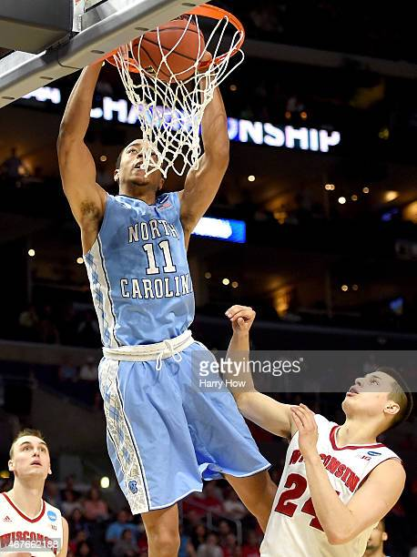 Brice Johnson of the North Carolina Tar Heels dunks the ball against Bronson Koenig of the Wisconsin Badgers in the firs thalf during the West...