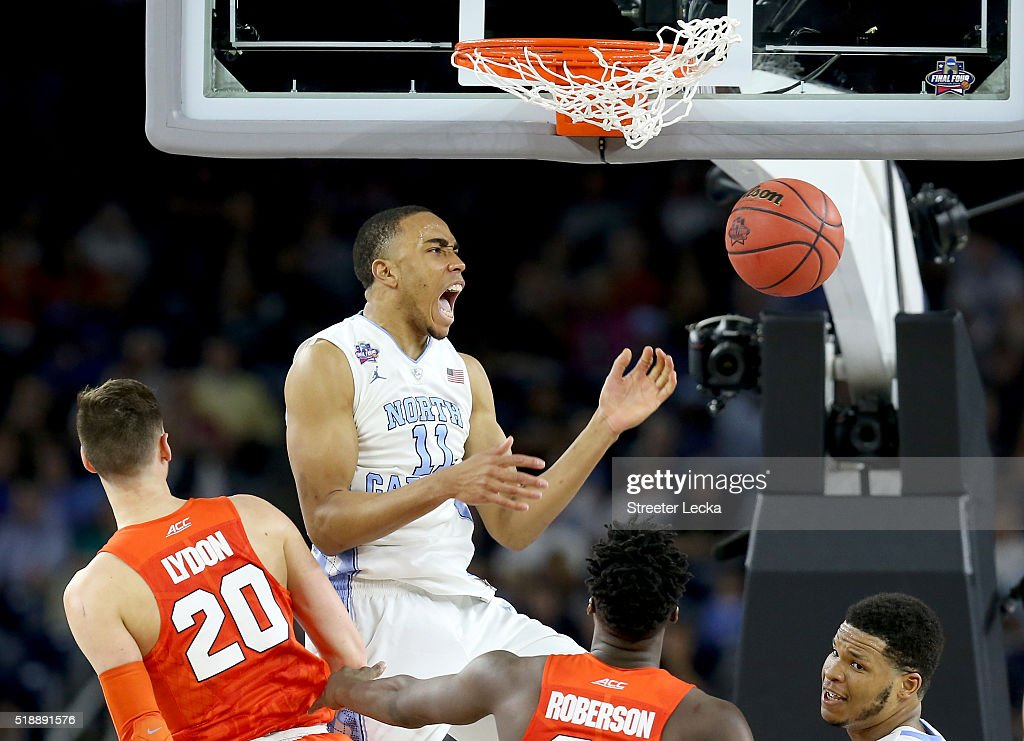 Brice Johnson of the North Carolina Tar Heels dunks the ball against Tyler Lydon of the Syracuse Orange in the second half during the NCAA Men's...
