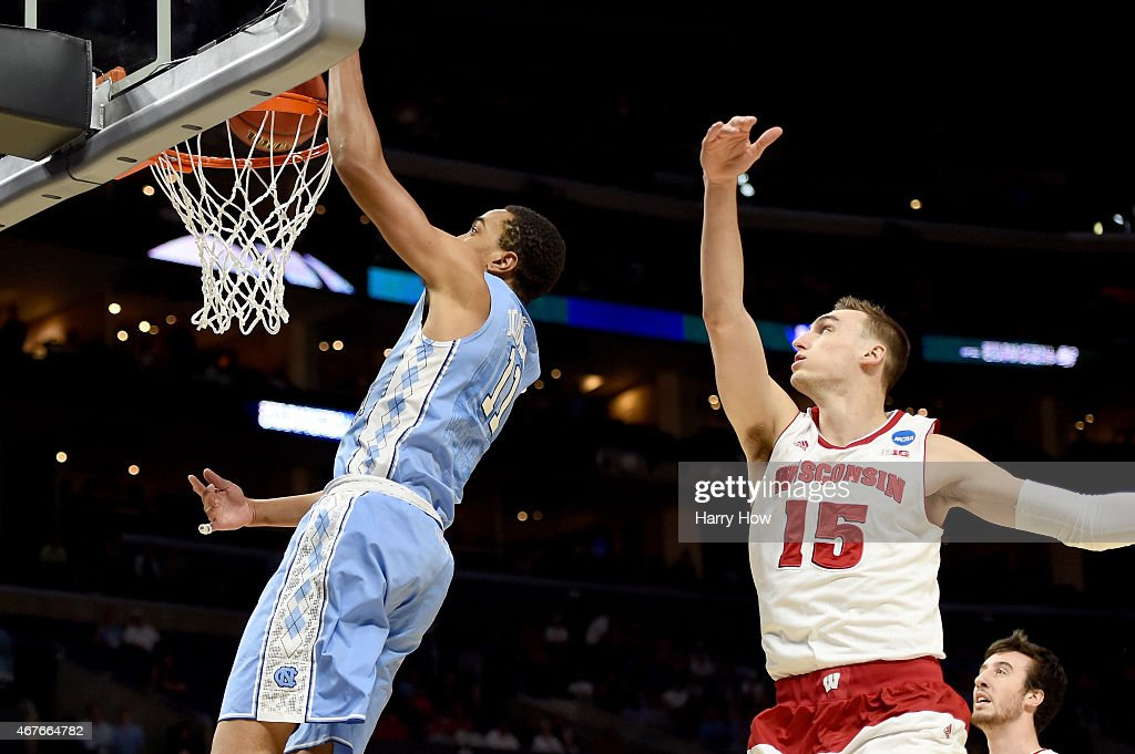 Brice Johnson of the North Carolina Tar Heels dunks the ball ahead of Sam Dekker of the Wisconsin Badgers in the first half during the West Regional...