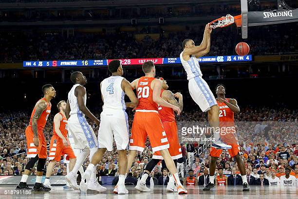 Brice Johnson of the North Carolina Tar Heels dunks the ball in the first half against the Syracuse Orange during the NCAA Men's Final Four Semifinal...