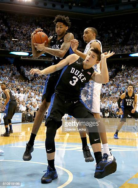 Brice Johnson of the North Carolina Tar Heels goes after a rebound against teammates Grayson Allen and Brandon Ingram of the Duke Blue Devils during...