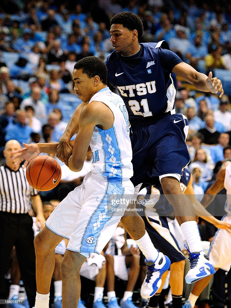 Brice Johnson #11 of the North Carolina Tar Heels is fouled by John Walton #21 of the East Tennessee State Buccaneers during play at Dean Smith Center on December 8, 2012 in Chapel Hill, North Carolina. North Carolina won 78-55.