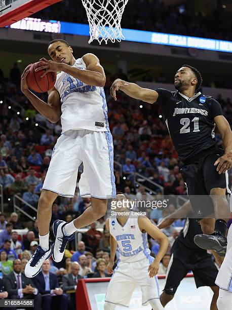 Brice Johnson of the North Carolina Tar Heels rebounds against Jalen Lindsey of the Providence Friars in the first half during the second round of...