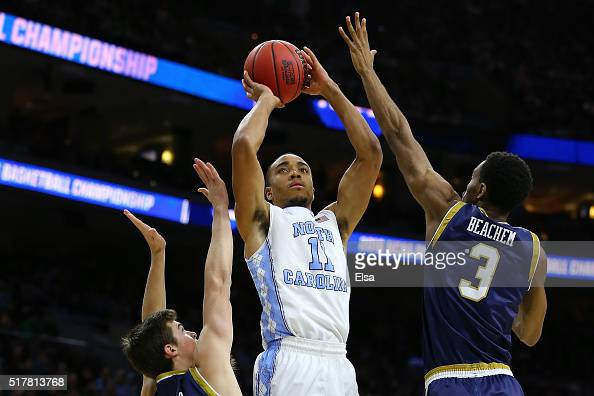 Brice Johnson of the North Carolina Tar Heels shoots the ball in the first half against Steve Vasturia and VJ Beachem of the Notre Dame Fighting...