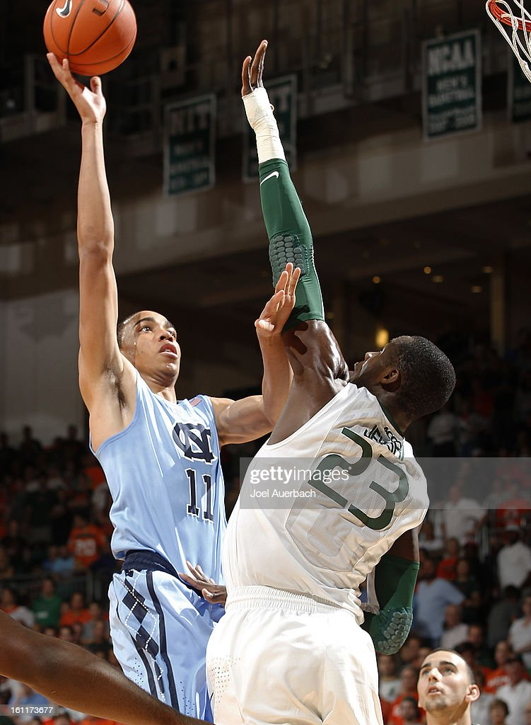 Brice Johnson #11 of the North Carolina Tar Heels shoots the ball over Tonye Jekiri #23 of the Miami Hurricanes during second half action on February 9, 2013 at the BankUnited Center in Coral Gables, Florida. Miami defeated North Carolina 87-61.