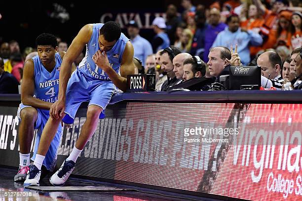 Brice Johnson of the North Carolina Tar Heels sits on the scorer's table in the second half during their game against the Virginia Cavaliers at John...