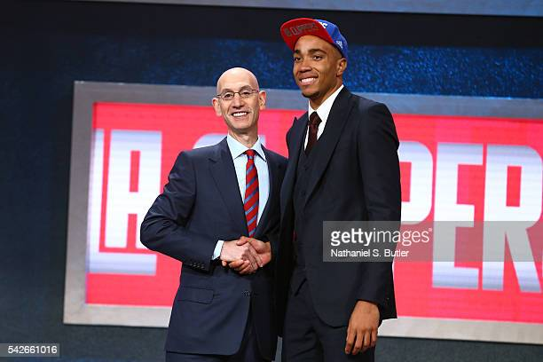 Brice Johnson shakes hands with NBA Commissioner Adam Silver after being selected number twenty five overall by the Los Angeles Clippers during the...