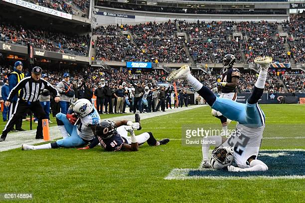 Brice McCain of the Tennessee Titans lays upside down after Da'Norris Searcy intercepted the football in the third quarter against the Chicago Bears...