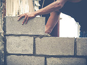 Manson or Brick builders are building walls in Thailand