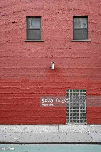 A brick building painted red