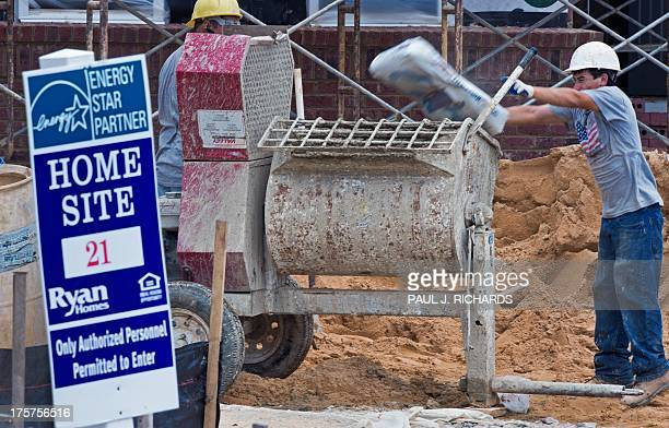 Brick masons load up a concrete mixer while building single family homes August 7 in Aldie Virginia AFP PHOTO/Paul J Richards