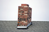 A red brick masonry chimney on a residential home.