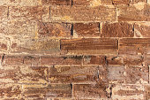 A close up of a brick wall.