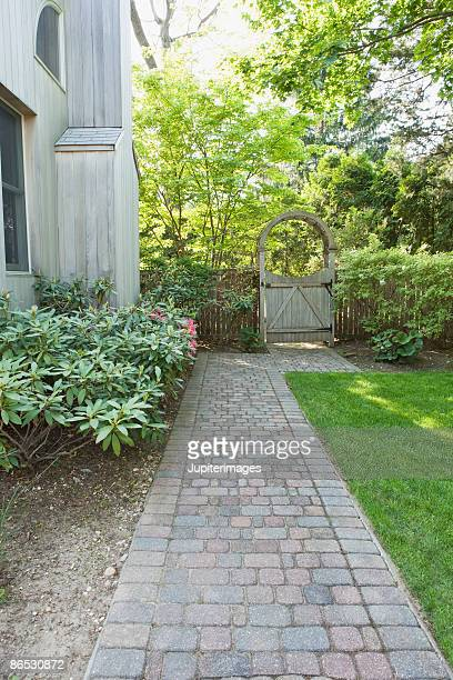 Brick walkway and wooden gate