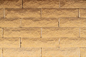 Brick wall of yellow brick. Creative vintage background