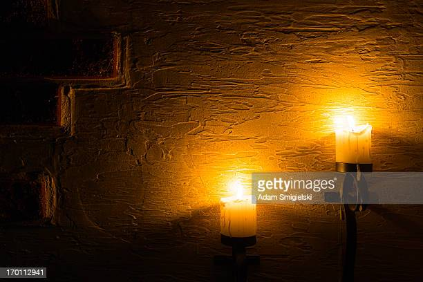 brick wall with candles