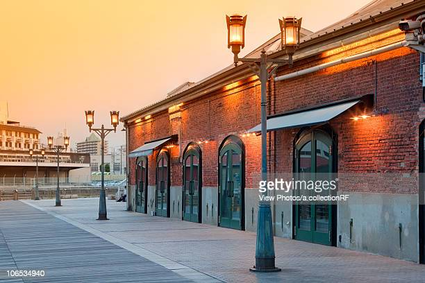 Brick warehouse in Harbor land at dusk, Kobe City, Hyogo Prefecture, Honshu, Japan