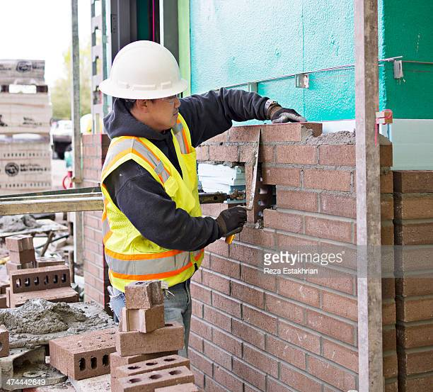 Bricklayer on new construction site