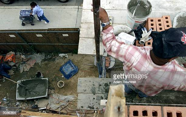 Bricklayers take a brake from to build a Habitat for Humanity house May 28 2003 in Bronx neighborhood of New York City Habitat for Humanity is...