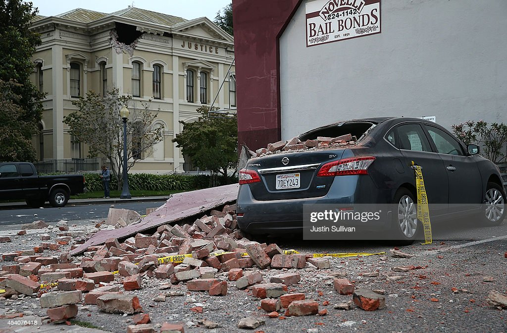 Bricks from a damaged building sit on a car following a reported 6.0 earthquake on August 24, 2014 in Napa, California. A 6.0 earthquake rocked the San Francisco Bay Area shortly after 3:00 am on Sunday morning causing damage to buildings and sending at least 70 people to a hospital with non-life threatening injuries.