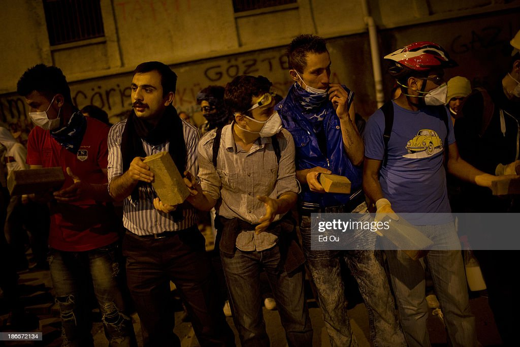 Bricks from the ground a dug up are passed by a human chain of demonstrators to be thrown at police during a clash in Istanbul Turkey on June 3 2013...