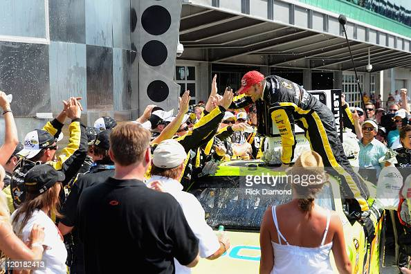 Brickyard 400 Winner Paul Menard celebrates at the Brickyard 400 presented by BigMachineRecordscom at Indianapolis Motorspeedway on July 31 2011 in...