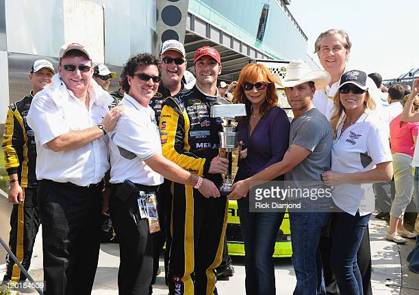 Brickyard 400 winner Paul Menard poses with team owner Richard Childress CEO and President of Big Machine Records Scott Borchetta winning team cheif...