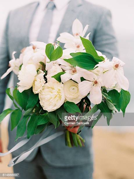Bridal bouquet held by a groom