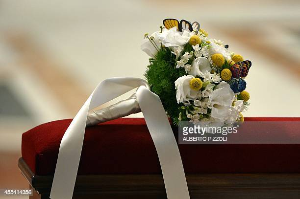 A bridal bouquet lays on a bench during a wedding ceremony celebrated as part of a mass by Pope Francis at St Peter's basilica on September 14 2014...