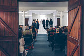 Bridal Party standing on stage in small hall