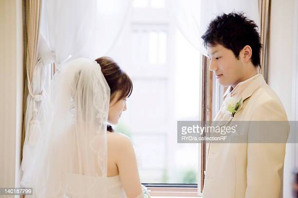 Bride and bridegroom standing face to face