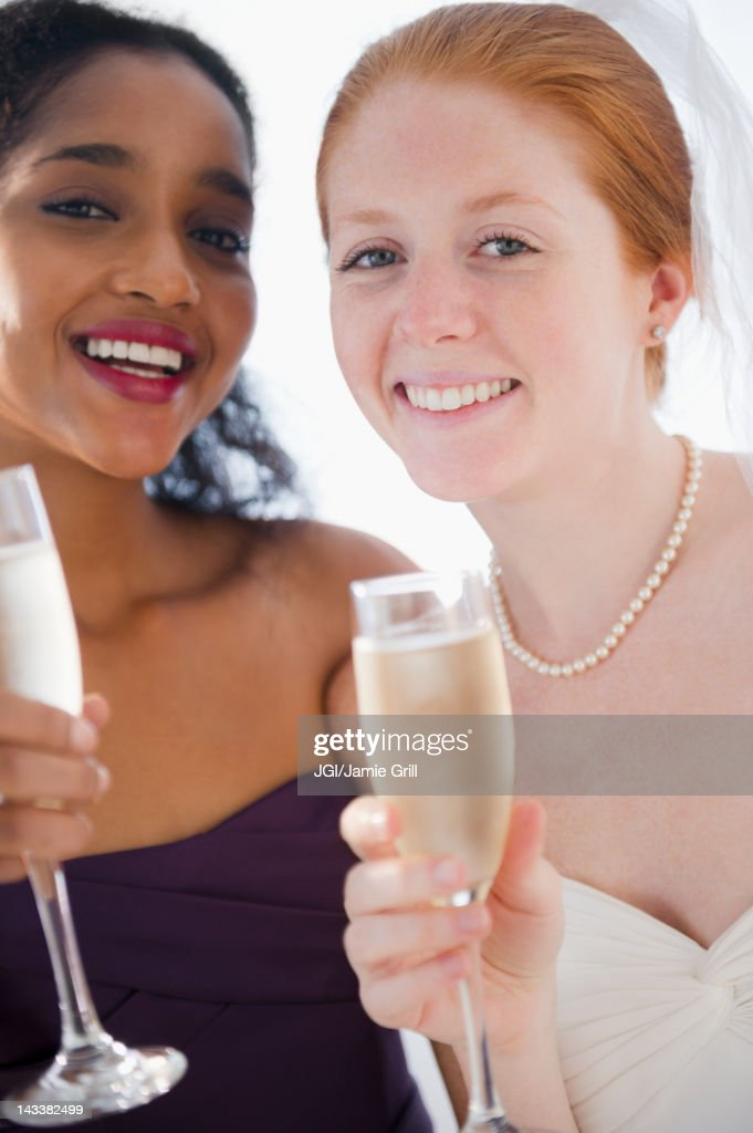 Bride and friend drinking Champagne : Stock Photo