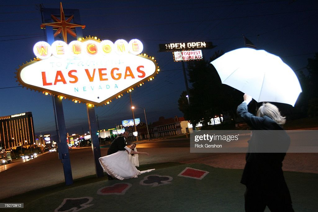 A bride and groom are photographed under the famous welcome to Las Vegas sign on July 7, 2007 in Las Vegas, Nevada. Wedding planners say a flood of couples were marrying on 7/7/07 due to the numerical and superstitious significance of the date.