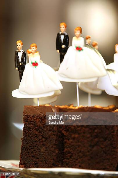 Bride and Groom cake decorations are seen at Corogate Cafe on April 28 2011 in Auckland New Zealand New Zealanders across the country prepare to...
